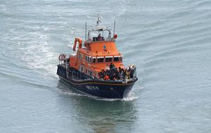 A group of people thought to be migrants are brought into Dover, Kent, by the RNLI following a small boat incident in the Channel (Andrew Matthews/PA)