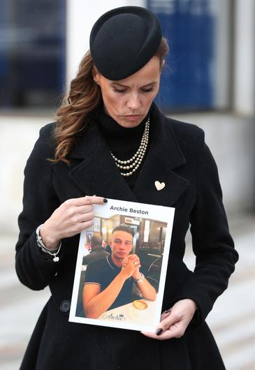 Becky Beston holds a photo of her son Archie who was fatally stabbed in Kingston in February last year (Jonathan Brady/PA)