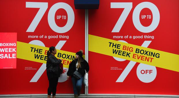 Shoppers outside the Gap store in London during the Boxing Day sales (Kisty O'Connor/PA)