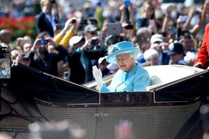 The Queen waving to the crowds on her way to the parade ground in 2018 (Pete Summers/PA)