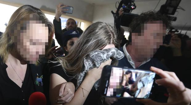 The 19 year-old British woman arriving at court in Cyprus (AP Photo/Petros Karadjias)