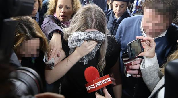 The 19 year-old British woman arrives at Famagusta District Court (AP Photo/Petros Karadjias)