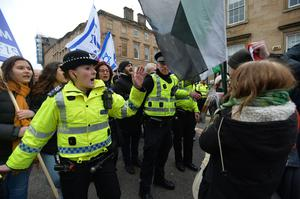 Police intervene as pro-Palestinian and pro-Israeli demonstrators face-off during the anti-racism rally in Glasgow (Mark Runnacles/PA)