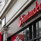 Santander has revealed UK profits slumped by 37% last year (Laura Lean/PA)