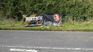 Floral tributes on the B4031 outside RAF Croughton (Steve Parsons/PA)