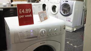 Rent-to-own stores offer goods from washing machines to TVs (Yui Mok/PA)