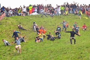 The annual cheese-rolling competition at Cooper's Hill in Brockworth, Gloucestershire, has been cancelled (PA)