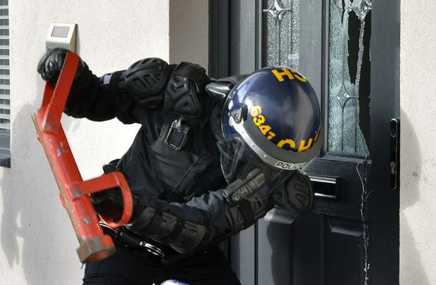 Police carrying out a raid during a crackdown on county lines drugs gangs (West Midlands Police/PA)
