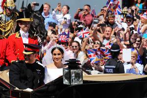 The Sussexes ride through Windsor in an Ascot Landau carriage after their wedding (Christopher Furlong/PA)