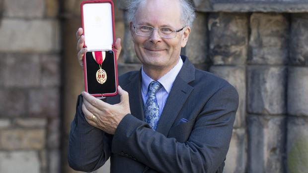 Professor Sir John Curtice after being knighted for services to the social sciences and politics from the Queen at the Palace of Holyroodhouse in Edinburgh in 2018 (Jane Barlow/PA)