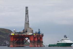 Protesters climbed on board the rig in the Cromarty Firth (Greenpeace/PA)