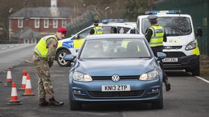 A member of the Royal Military Police 150 Provost Company works alongside North Yorkshire Police at a vehicle check point near Catterick Barracks (Danny Lawson/PA)