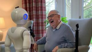 Pepper the robot with an elderly man (University of Bedfordshire/PA)