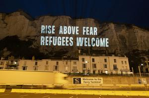 The White Cliffs of Dover lit up with a series of projections in support of migrant welfare (Freedom from Torture/POW)