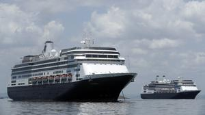 The Zaandam cruise ship, left, and the Rotterdam, seen here in Panama City before transiting the Panama Canal (Arnulfo Franco/AP)