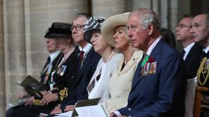 Philip May, Prime Minister Theresa May, the Duchess of Cornwall and the Prince of Wales attend the Royal British Legion Service of Remembrance at Bayeux Cathedral (Jane Barlow/PA)