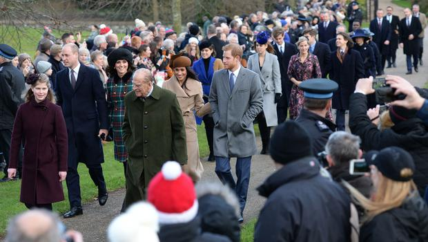 Harry and Meghan joining the royals on their way to the Christmas Day morning church service at St Mary Magdalene Church in Sandringham, Norfolk in 2017 (Joe Giddens/PA)