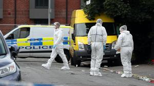 Police at the scene of a fatal shooting in Manchester (Peter Byrne/PA)