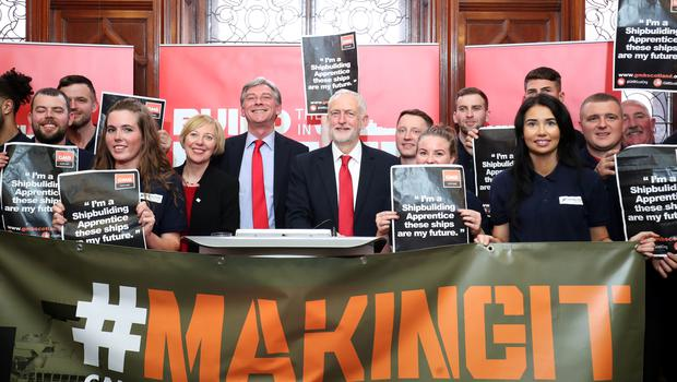 Mr Corbyn and Mr Leonard with apprentices and engineers at the Fairfield Ship Building Museum in Glasgow (Jane Barlow/PA)