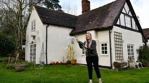 Jemma Nicklin, 23, celebrates with a bottle of champagne during her first visit to Shrubbery Farm in Longnor, near Shrewsbury, which she won in an online draw (Jacob King/PA)