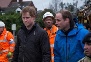 Harry and William, the Dukes of Sussex and Cambridge, visited Datchet, Berkshire, during flooding in 2014 (Ki Price/PA)