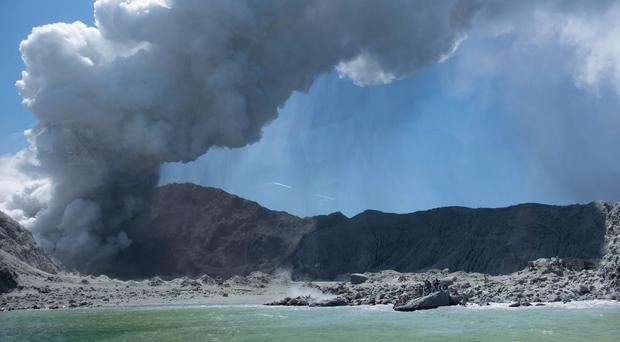White Island seen erupting on Monday. Five people are confirmed dead, with eight more missing (Michael Schade/AP)