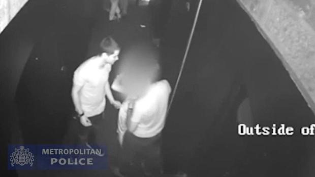 CCTV issued by the Metropolitan Police shows Ferdinando Orlando and Lorenzo Costanzo standing either side of the victim and escorting her out of a maintenance room in the Toy Room nightclub (Met Police/PA)