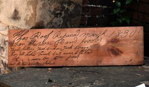 An uncovered roof board with an inscription etched into it from 1830 (Steve Mettam/Wentworth Woodhouse Preservation Trust)