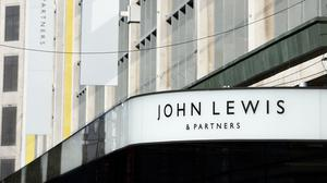 The John Lewis Partnership said it will close 50 John Lewis shops on Monday (Kirsty O'Connor/PA)