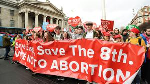 Anti-abortion protesters march through Dublin to campaign for the Eighth Amendment of the constitution to be retained in the referendum (Caroline Quinn/PA)