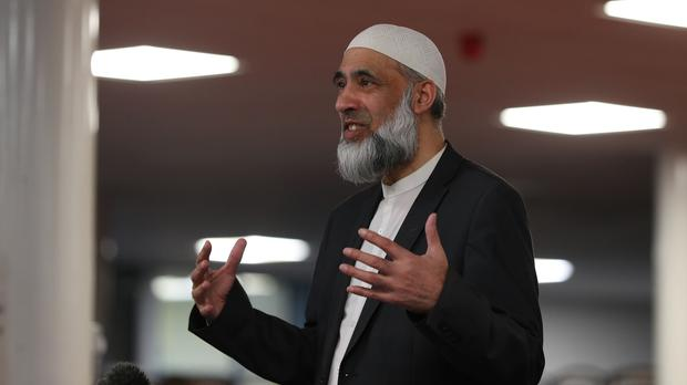 Dr Musharraf Hussain Al-Azhari, an Imam from Nottingham, speaks to members of the Muslim community about the benefits of having the Covid-19 vaccination (Peter Byrne/PA)