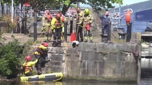 Firefighters used a raft to rescue the cat (Tom Eden/PA)