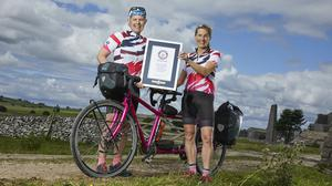 Cat Dixon, left, and Raz Marsden travelled the world on a tandem bike (Guinness World Records/PA)