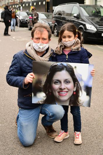 Richard Ratcliffe with daughter Gabriella during a protest on Monday outside the Iranian Embassy in London (Ian West/PA)