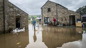 Flood water outside Dales Cafe and Cakery in Yorkshire (Danny Lawson/PA)