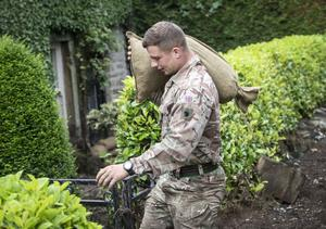 A soldier from 2 Yorks stacks sand bags in Grinton, North Yorkshire (Danny Lawson/PA)
