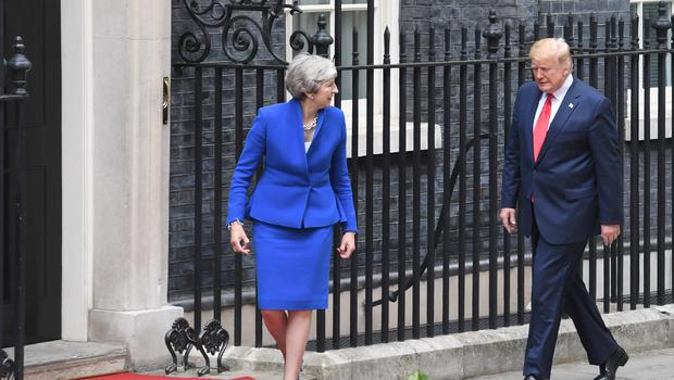 Prime Minister Theresa May welcoming US President Donald to Downing Street, London, on the second day of his state visit to the UK.