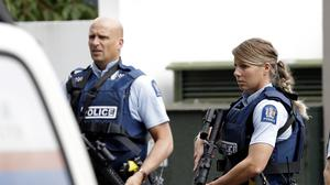 Armed police patrol outside a mosque in central Christchurch