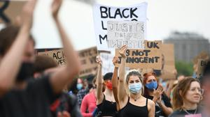 People participate in a Black Lives Matter protest rally in Hyde Park (Victoria Jones/PA)