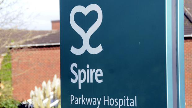 A sign outside the Spire privately run Parkway Hospital in Solihull (David Jones/PA)