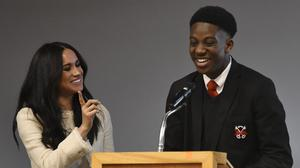 The Duchess of Sussex (left) smiles as head boy Aker Okoye speaks in an assembly during her surprise visit to Robert Clack Upper School in Dagenham, east London, to celebrate International Women's Day (Ben Stansall/PA)