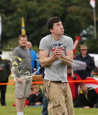 Competitors take part in the 45-metre catch discipline during the World Egg Throwing Championships at the Swaton Vintage Day fayre near Swaton in Lincolnshire (PA)