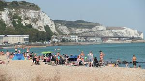 People enjoying the warm weather on a beach in Dover, Kent (PA)