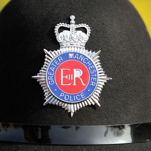 Two people are being questioned by Greater Manchester Police after a body was found in a house in Gorton, Manchester