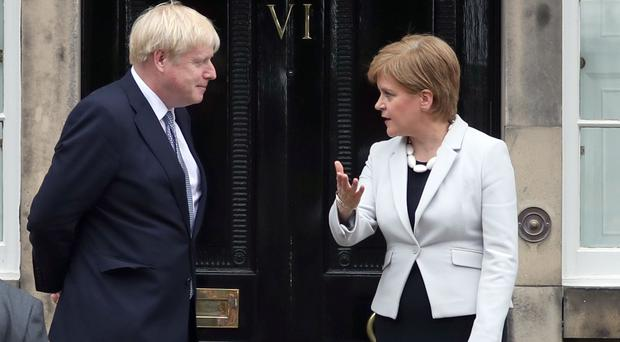 Scotland's First Minister Nicola Sturgeon and Prime Minister Boris Johnson outside Bute House in Edinburgh (Jane Barlow/PA)