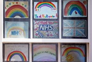 Pictures of rainbows with supportive messages for the NHS displayed in a window in Downing Street (Yui Mok/PA)