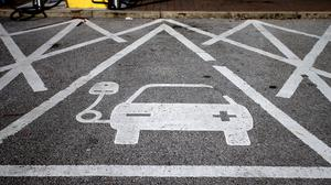 An electric car charging point (Peter Byrne/PA)