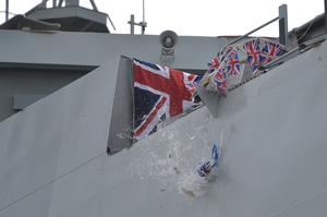 A bottle from Nelson's Gin Distillery and Gin School was smashed onto the ship during the ceremony (John Linton/PA)