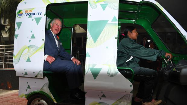 The Prince of Wales is given a demonstration of an e-rickshaw (Victoria Jones/PA)