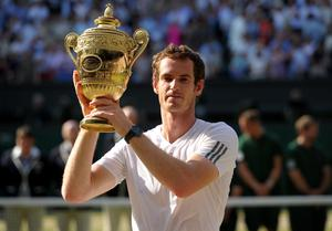 Sir Andy celebrates winning his first Wimbledon title in 2013. Adam Davy/PA Wire